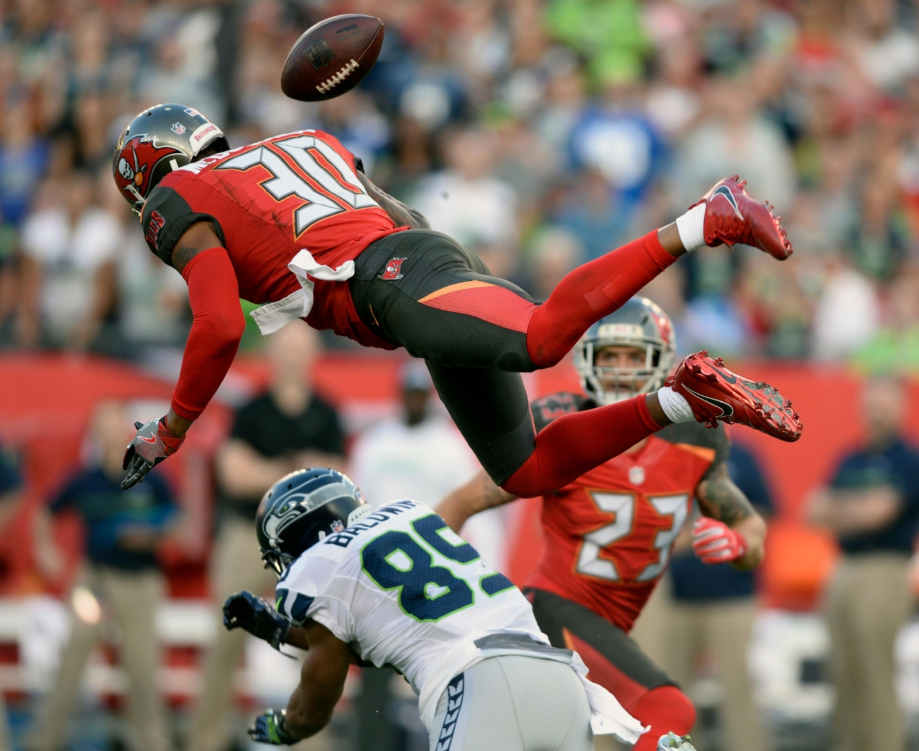 Seattle Seahawks wide receiver Doug Baldwin (89) loses the football as he is hit by Tampa Bay Buccaneers free safety Bradley McDougald (30) during the second quarter of an NFL football game Sunday, Nov. 27, 2016, in Tampa, Fla. McDougald was called for pass interference on the play. (AP Photo/Jason Behnken)