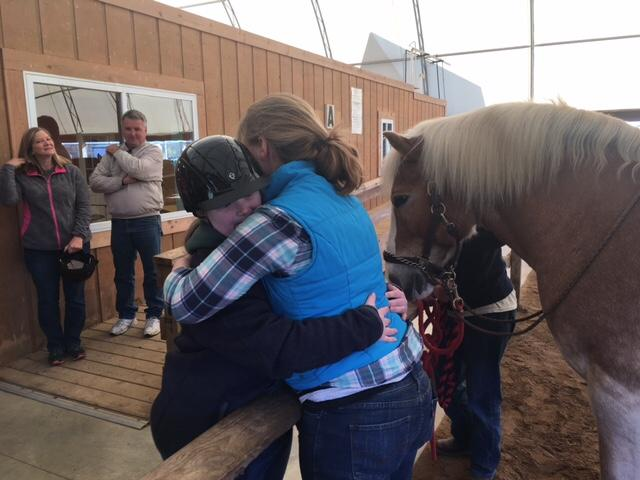 Camper and trainer embrace after a job well done at the{&amp;nbsp;}Fowler Center for Outdoor Learning. ( Photo: Courtney Wheaton.){&amp;nbsp;}<p></p>