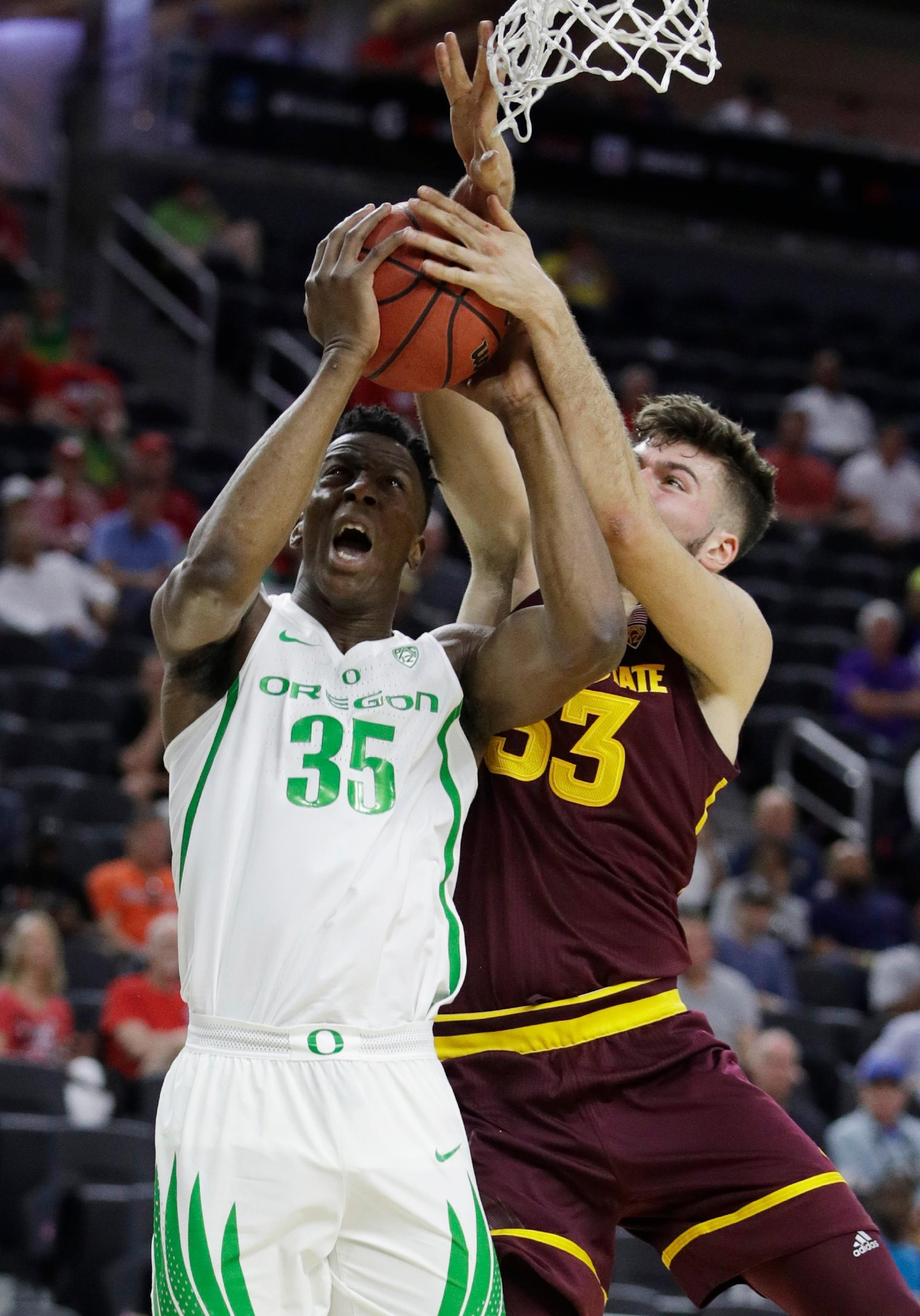 Arizona State's Ramon Vila, right, fouls Oregon's Kavell Bigby-Williams during the first half of an NCAA college basketball game in the quarterfinals of the Pac-12 men's tournament Thursday, March 9, 2017, in Las Vegas. (AP Photo/John Locher)