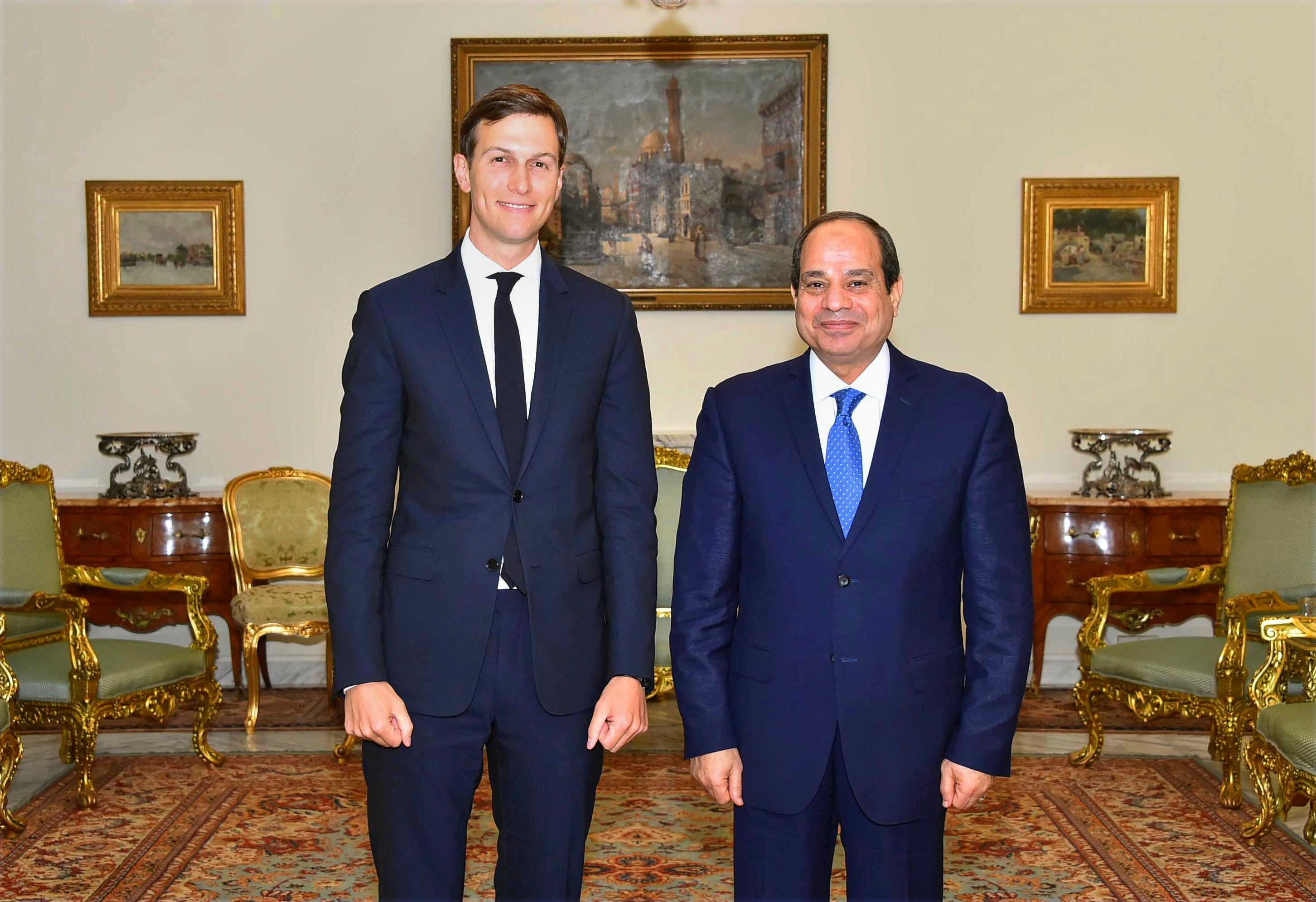 In this photo provided by Egypt's state news agency, MENA, Egypt's President Abdel-Fattah el-Sissi, right, poses for a photo with White House adviser Jared Kushner, in Cairo, Egypt, Wednesday, Aug. 23, 2017. El-Sissi and Egypt's foreign minister have met with Kushner just hours after the Trump administration cut or delayed hundreds of millions of dollars in aid to Cairo over human rights concerns. Kushner, who is also President Donald Trump's son-in-law, was in Cairo as part of a Middle East tour aimed at exploring ways to revive Israeli-Palestinian peace talks, which last collapsed in 2014. (MENA via AP)