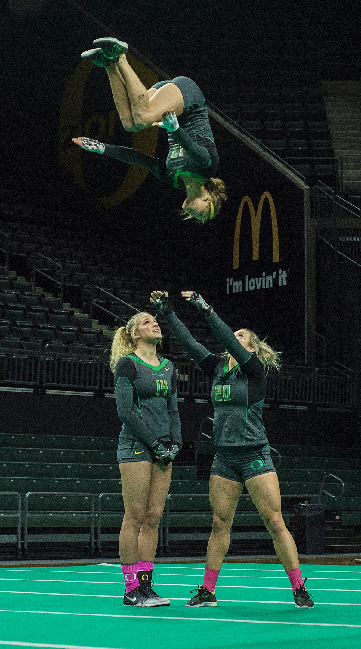 The Oregon Ducks Acro and Tumbling team defeated Hawaii Pacific in their second meet of the season and their first home meet with a score of 280.10 to 267.595. The Ducks won all six categories: 38.45 to 38.30 in compulsory; 29.55 to 28.55 in acro; 29.50 to 28.40 in pyramid; 29.10 to 27.50 in toss; 56.30 to 54.075 in tumbling; and 97.20 to 90.77 in team. The Ducks next face off against their arch rivals the Baylor Bears at Baylor February 24 and then return to Matt Knight Arena for a Tri Meet against Quinnipac and Gannon on March 11. Photo by Abigail Winn, Oregon News Lab