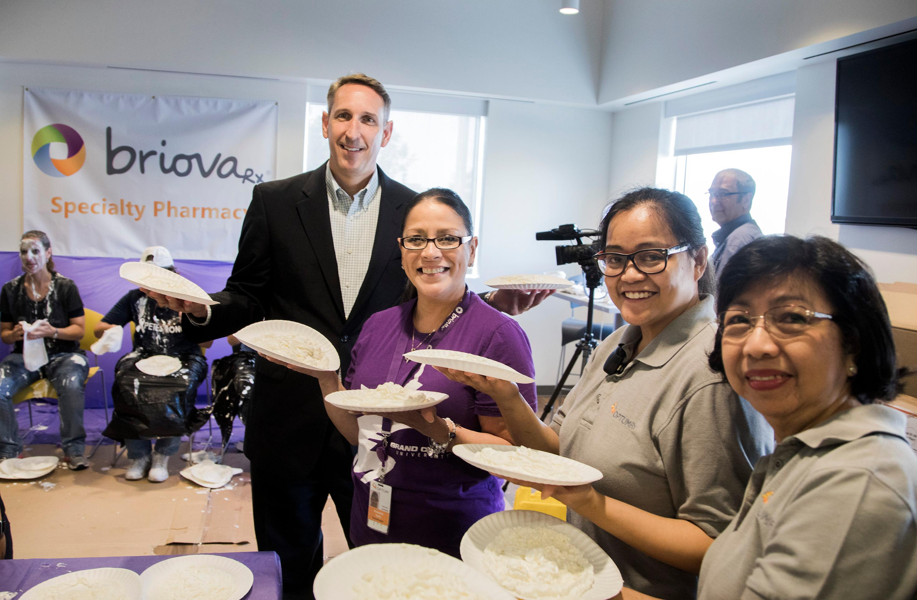 State Sen. Scott Hammond and Optum employees Victoria Natal, Eloisa Macapagal and Emelinda McManus show off the pies that will be thrown Wednesday, July 26, 2017, at senior leaders to raise funds for the Southern Nevada Chapter of the Leukemia & Lymphoma Society and recruit people to participate in its 2017 Light the Night Walk in November. (Photo courtesy of Jeff Scheid)