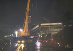 Long, Slow Cleanup of Derailed Train Begins Along I-5