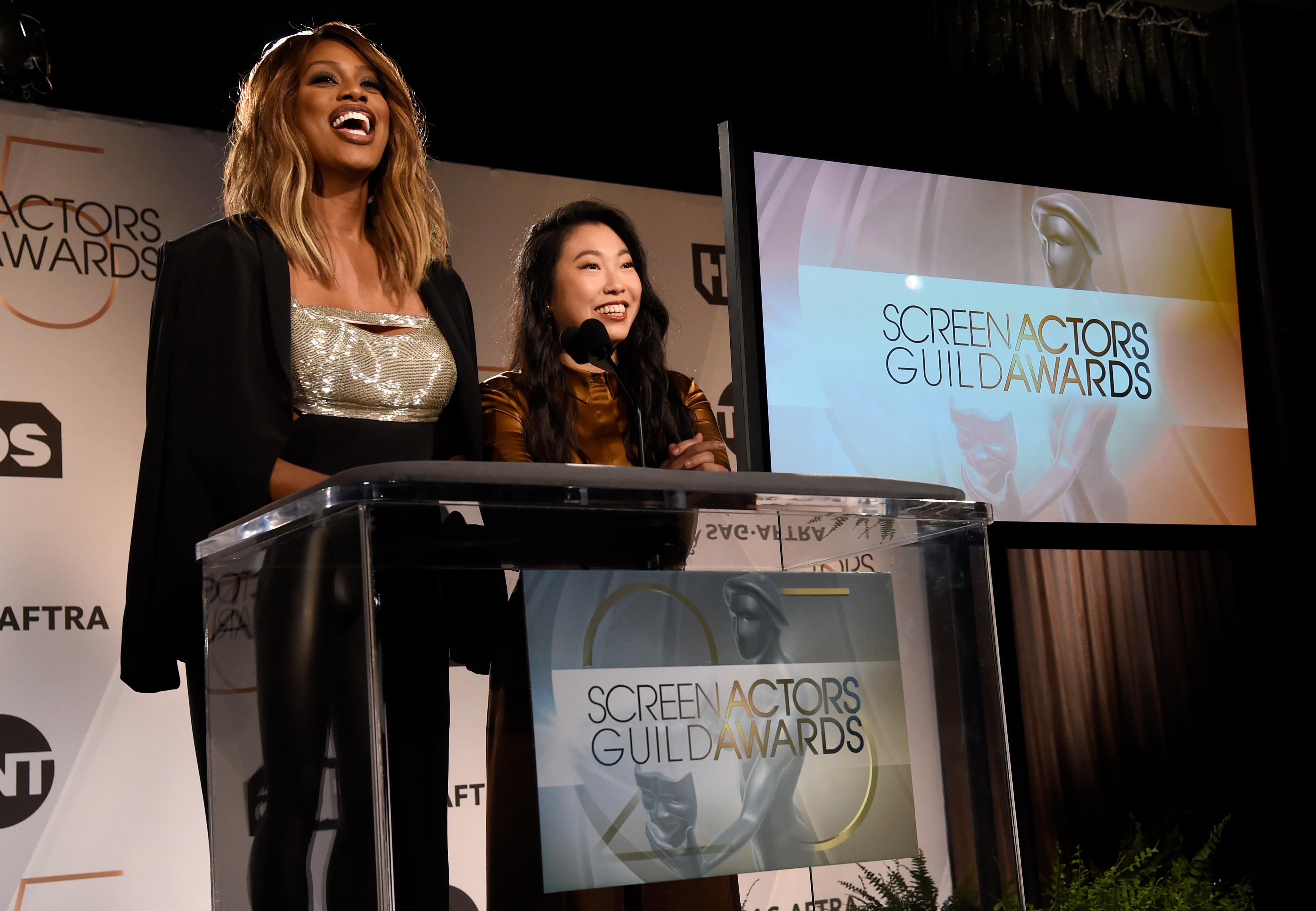 Presenters Laverne Cox, left, and Awkwafina announce nominations for the 25th annual Screen Actors Guild Awards at the Pacific Design Center on Wednesday, Dec. 12, 2018, in West Hollywood, Calif. (Photo by Chris Pizzello/Invision/AP)