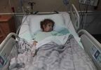 Girl in hospital after falling off playset.JPG