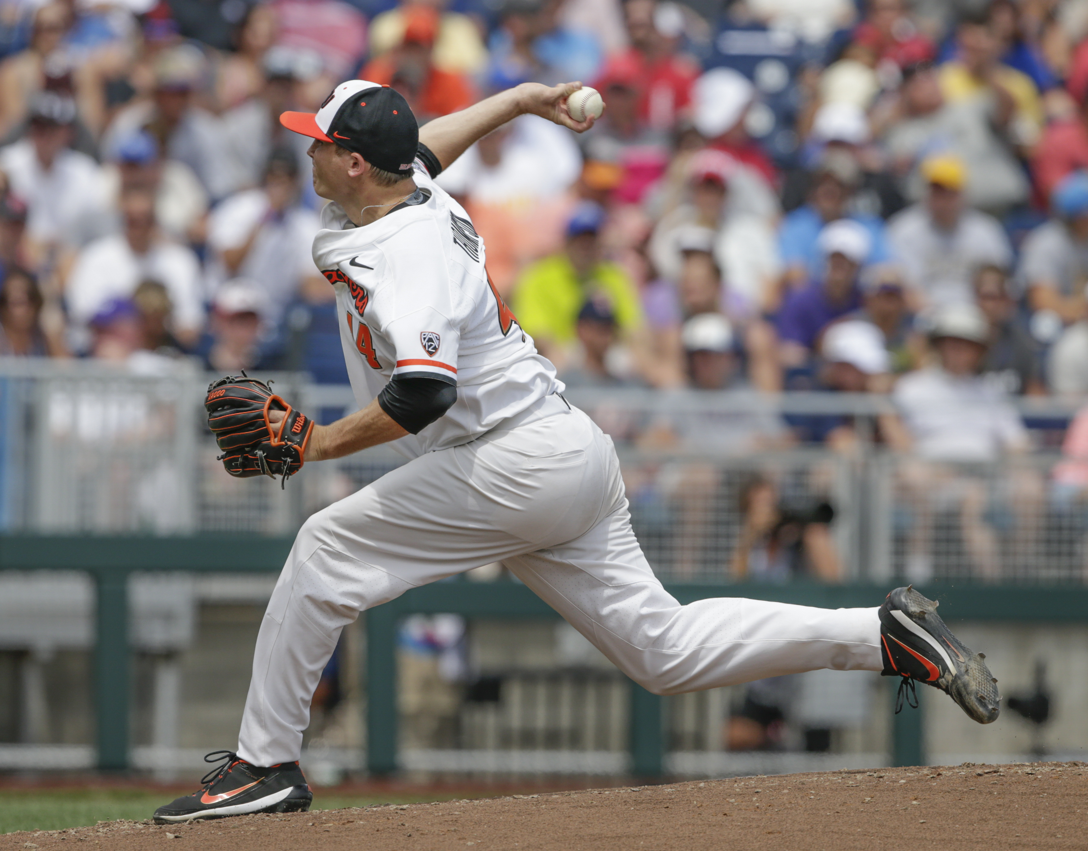 Oregon State pitcher Jake Thompson (44) works against Cal State Fullerton during the first inning of an NCAA mens College World Series baseball game in Omaha, Neb., Saturday, June 17, 2017. (AP Photo/Nati Harnik)