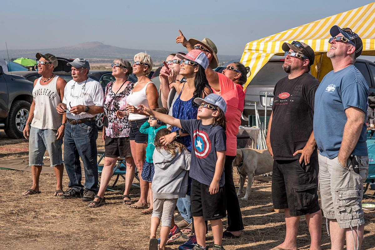 Family and friends gather to watch the moon move over the sun in the Solar Port campgrounds in Madras, Oregon. Photo by Cheyenne Thorpe, Oregon News Lab