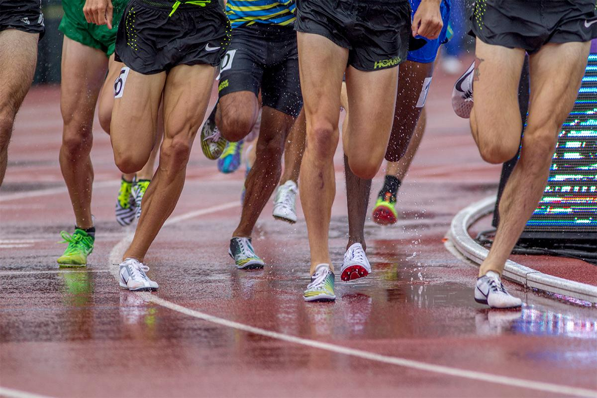Rain come thundering down in the earlier half of the day at Hayward field. But the athletes still took too the track. Photo by August Frank, Oregon News Lab
