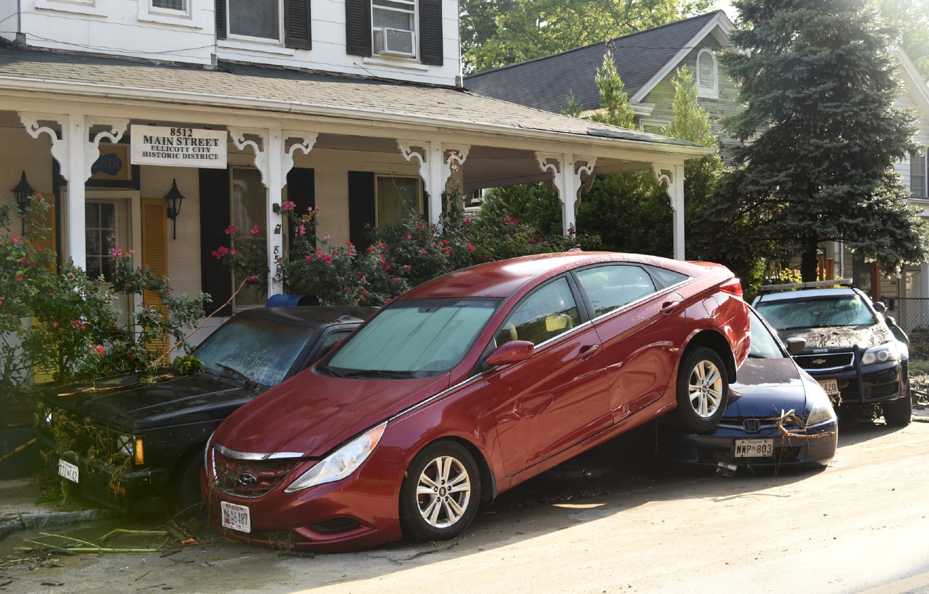 Vehicles collide each other on Main Street after Saturday night's flooding in Ellicott City, Md., Sunday, July 31, 2016. Historic, low-lying Ellicott City, Maryland, was ravaged by floodwaters Saturday night, killing a few people and causing devastating damage to homes and businesses, officials said. (Amy Davis/The Baltimore Sun via AP)