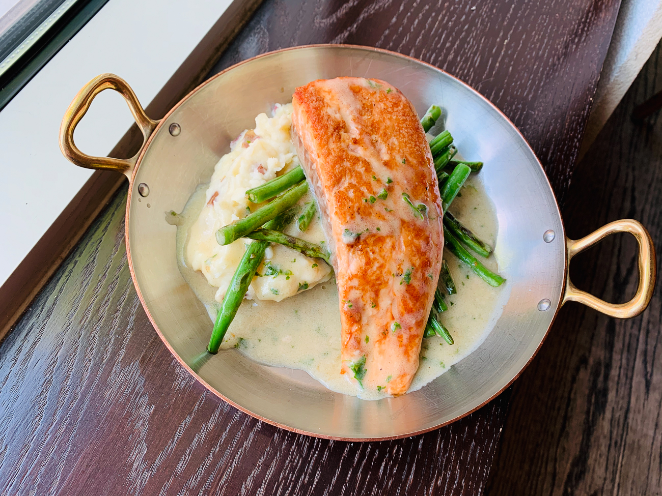 Salmon with{ }citrus beurre blanc, capers, mashed redskins, and haricots verts / Image courtesy of The Mercer OTR // Published: 5.14.20