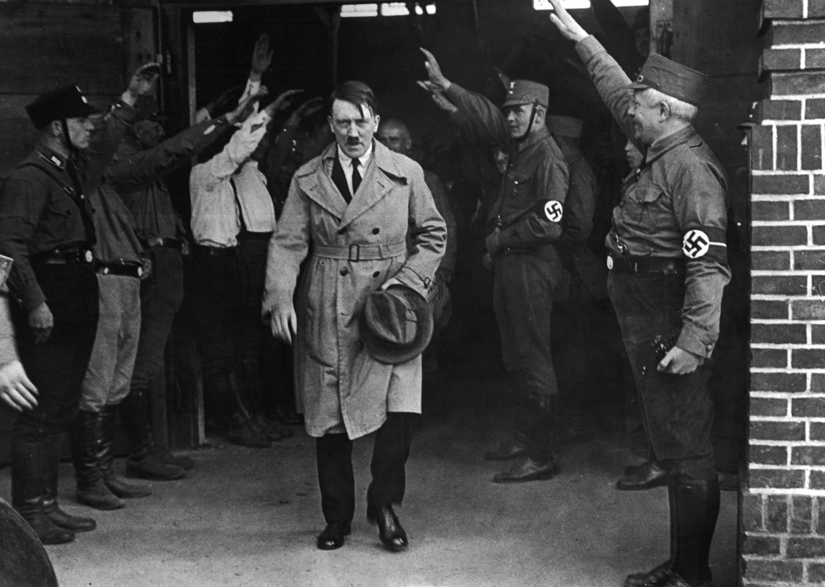 FILE - In this Dec. 5, 1931 file photo Adolf Hitler, leader of the National Socialists, emerges from the party's Munich headquarters. Historical documents show Adolf Hitler enjoyed special treatment, including plentiful supplies of beer, during his time in Landsberg prison.  (AP Photo/file)