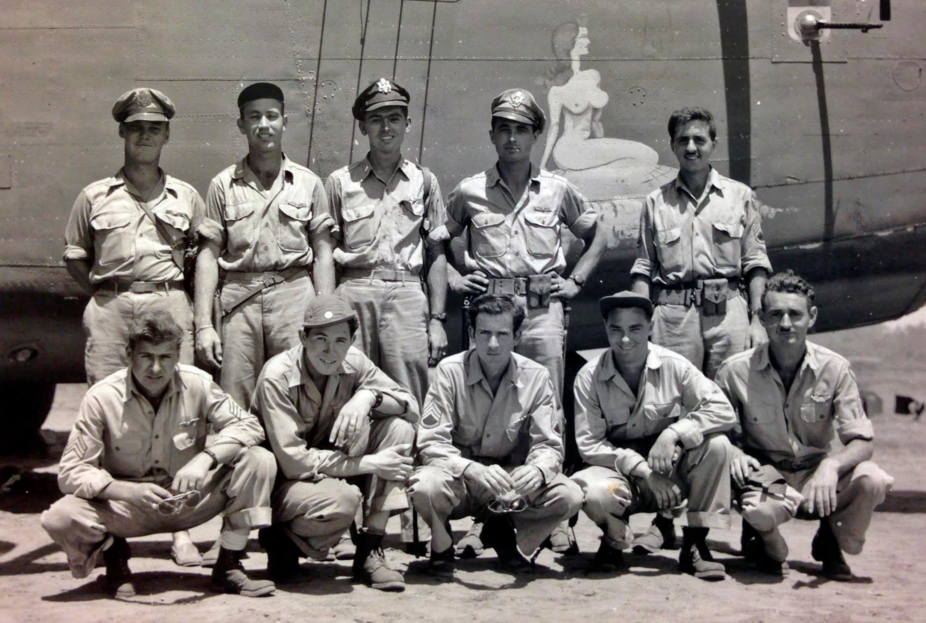 This circa 1943 U.S. Army Air Force photo from the Kelly Family Research Project shows Lt. Tom Kelly, center left, rear, with members of the crew of a B-24 bomber that was was shot down in Hansa Bay in what is now Papua New Guinea during World War II. When Kelly's relatives got word that his bomber had been found, a wave of exhilaration mixed with grief washed over family members. Although relatives who never met Kelly had pieced much of his life story together over the years, they never knew what happened when his plane was shot down off the coast of Papua New Guinea in 1944. They got their answer recently when the group Project Recover found the B-24 bomber under 213 feet of water. (Kelly Family Research Project via AP)
