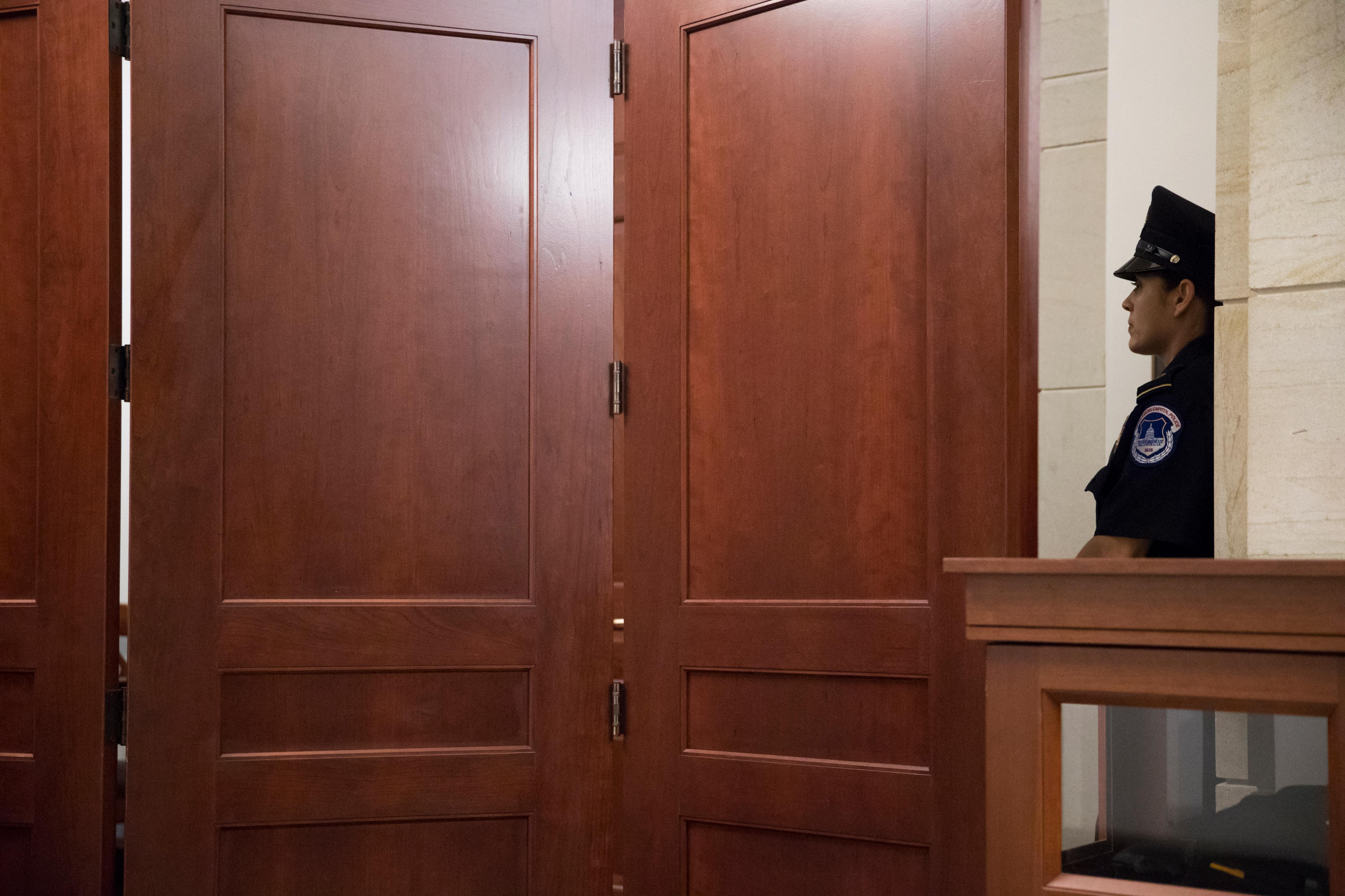 A U.S. Capitol Police officer stands watch while Donald Trump Jr., is interviewed behind closed doors by Senate Judiciary Committee staff investigating the meddling and possible Russian links to President Donald Trump's 2016 presidential campaign, at the Capitol in Washington, Thursday, Sept. 7, 2017.  (AP Photo/J. Scott Applewhite)