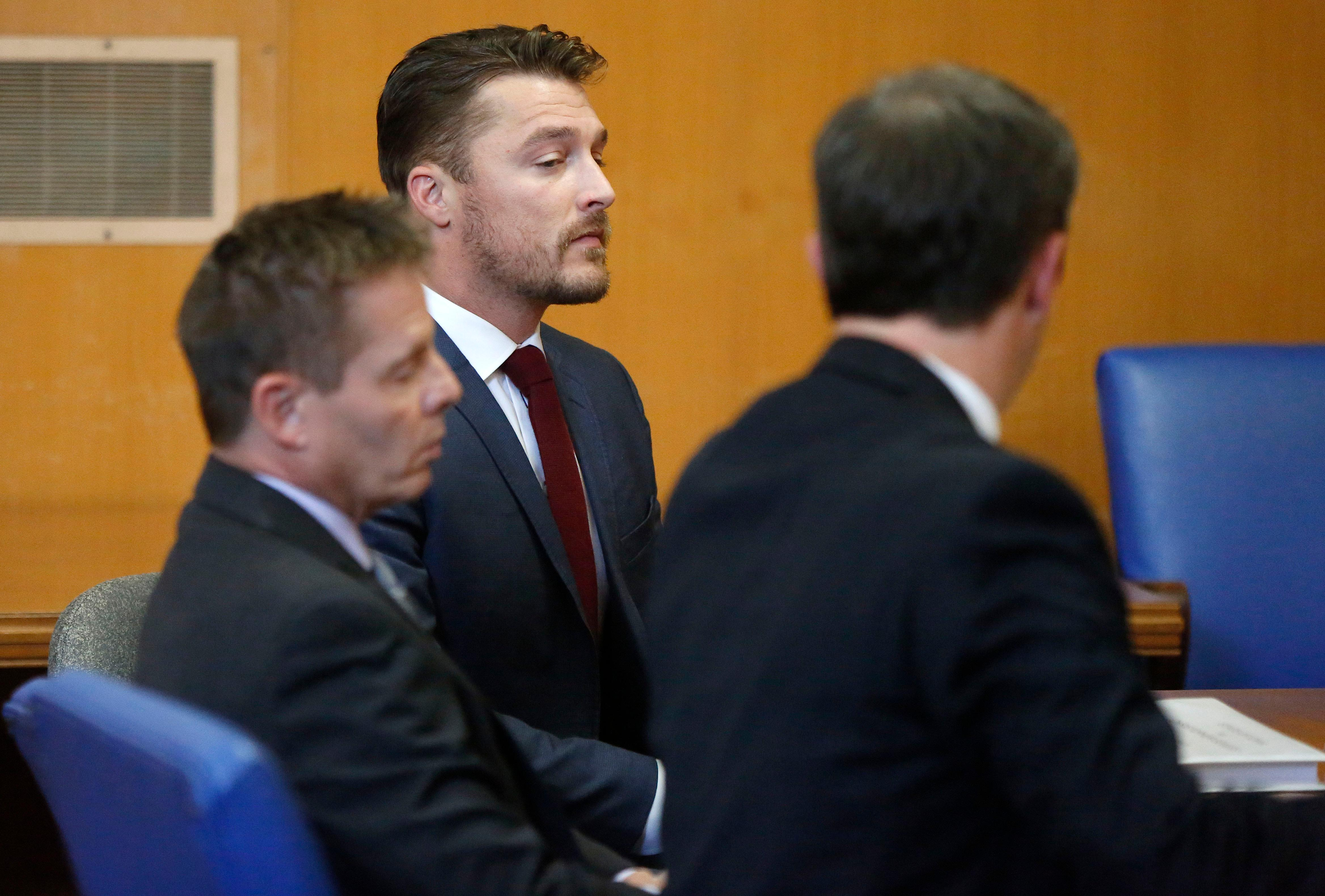 Chris Soules appears for a hearing with is lawyers Robert Montgomery and Brandon Brown in Buchanan County District Court Thursday, Sept. 14, 2017, in Independence, Iowa. Reality TV star Soules is charged with leaving the scene in a fatal April crash near Aurora, Iowa. (MATTHEW PUTNEY, The Courier /POOL)