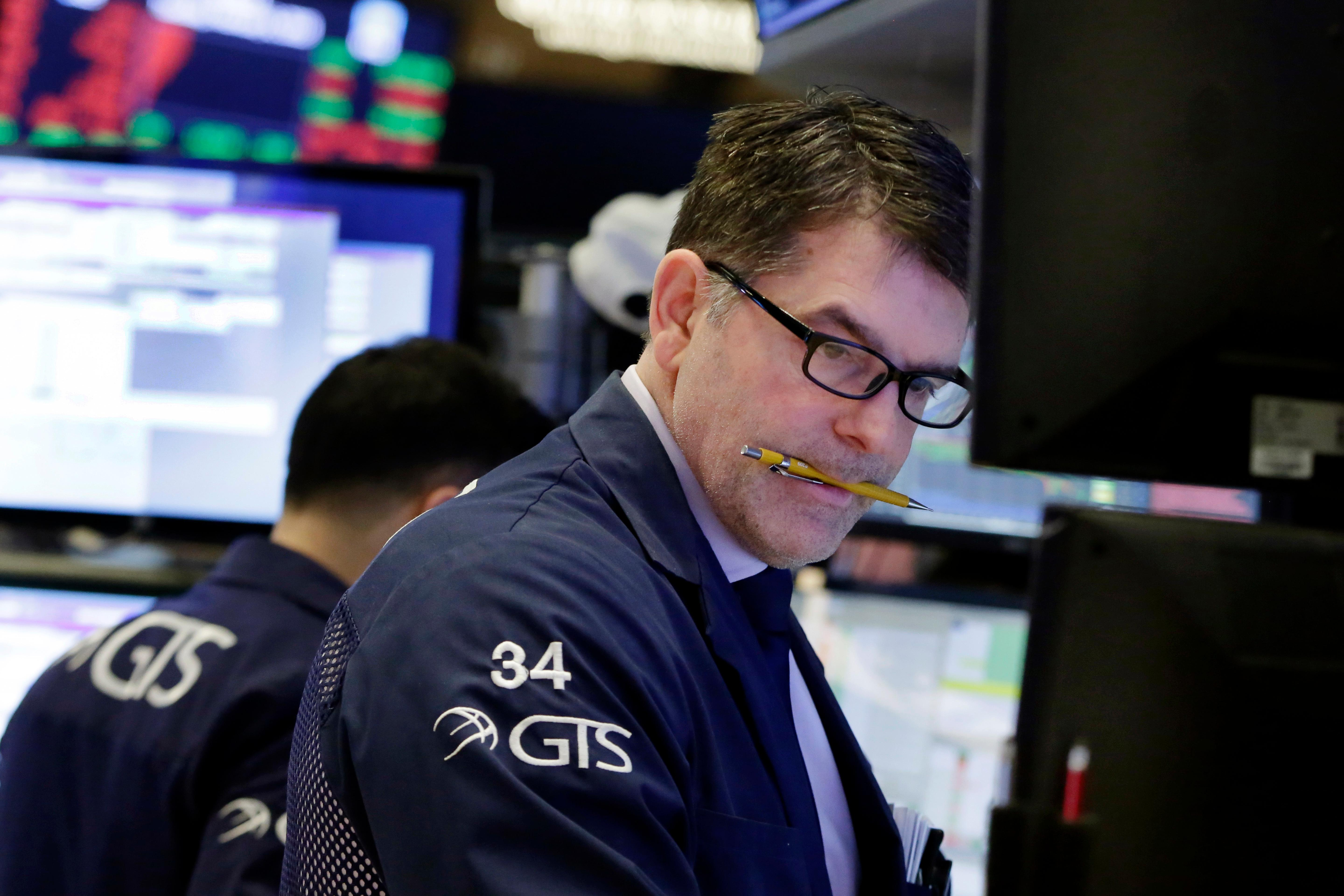 Specialist David Haubner works on the floor of the New York Stock Exchange, Tuesday, Feb. 6, 2018. The Dow Jones industrial average fell as much as 500 points in early trading, bringing the index down 10 percent from the record high it reached on Jan. 26. (AP Photo/Richard Drew)<p></p>