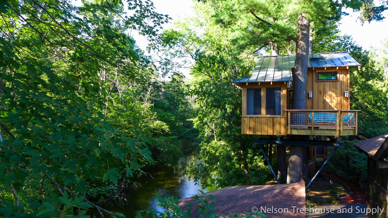 Many of us here in the PNW are familiar with 'Treehouse Masters,' the Animal Planet show where Fall City's Pete Nelson and crew travel across the country to build incredible treehouses for a lucky few.  With the show's next season just underway and the local connection - we thought we'd take a look at all the treehouses they built in 2016. We'll do one 'Treehouse of the Day' a day until we run out!   Today's treehouse was built in Berrien, Michigan - and was a husband's surprise anniversary gift to his wife, who loves Swiss Family Robinson. While their treehouse draws inspiration from the story, it's much more advanced that it's castaway motivation. Full episodes at animalplanet.com. (Image: Animal Planet)