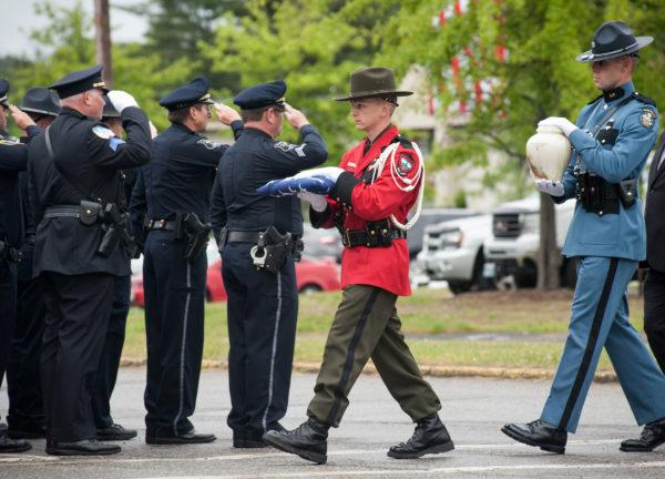Law enforcement officials carry in the ashes of Fryeburg Police Officer Nathan M. Desjardins for the  Law Enforcement Tribute Friday morning where thousands came to honor the fallen officer.   (Linda Coan O'Kresik | BDN)