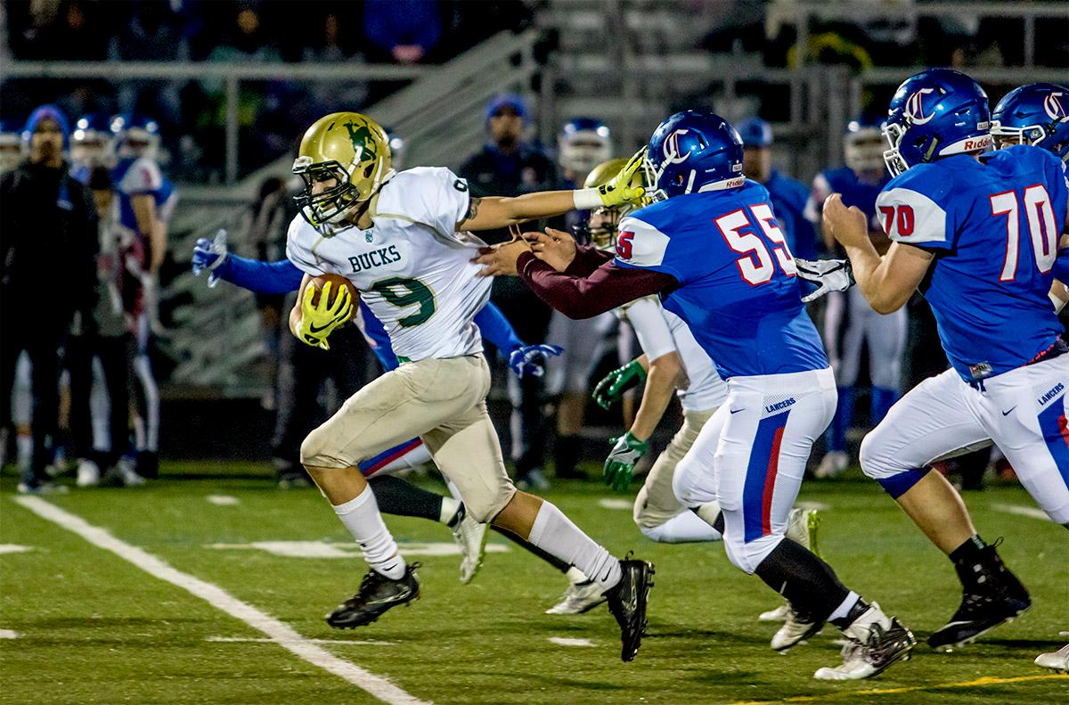 The Buckaroos' Aiden Patterson (#9) runs for the end zone to score a touchdown for the Buckaroos. The Churchill Lancers defeated the Pendleton Buckaroos 42-15, in the first round of the state 5A playoffs. Photo by August Frank, Oregon News Lab