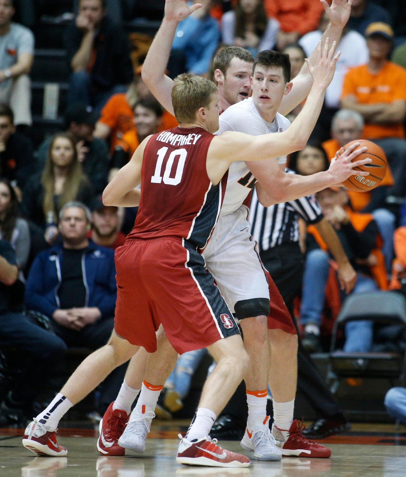Oregon State's Drew Eubanks is double-teamed by Stanford's Michael Humphrey, front, and Grant Verhoeven, rear, during the second half of an NCAA college basketball game in Corvallis, Ore., Thursday, Jan. 19, 2017. Stanford won 62-46. (AP Photo/Timothy J. Gonzalez)