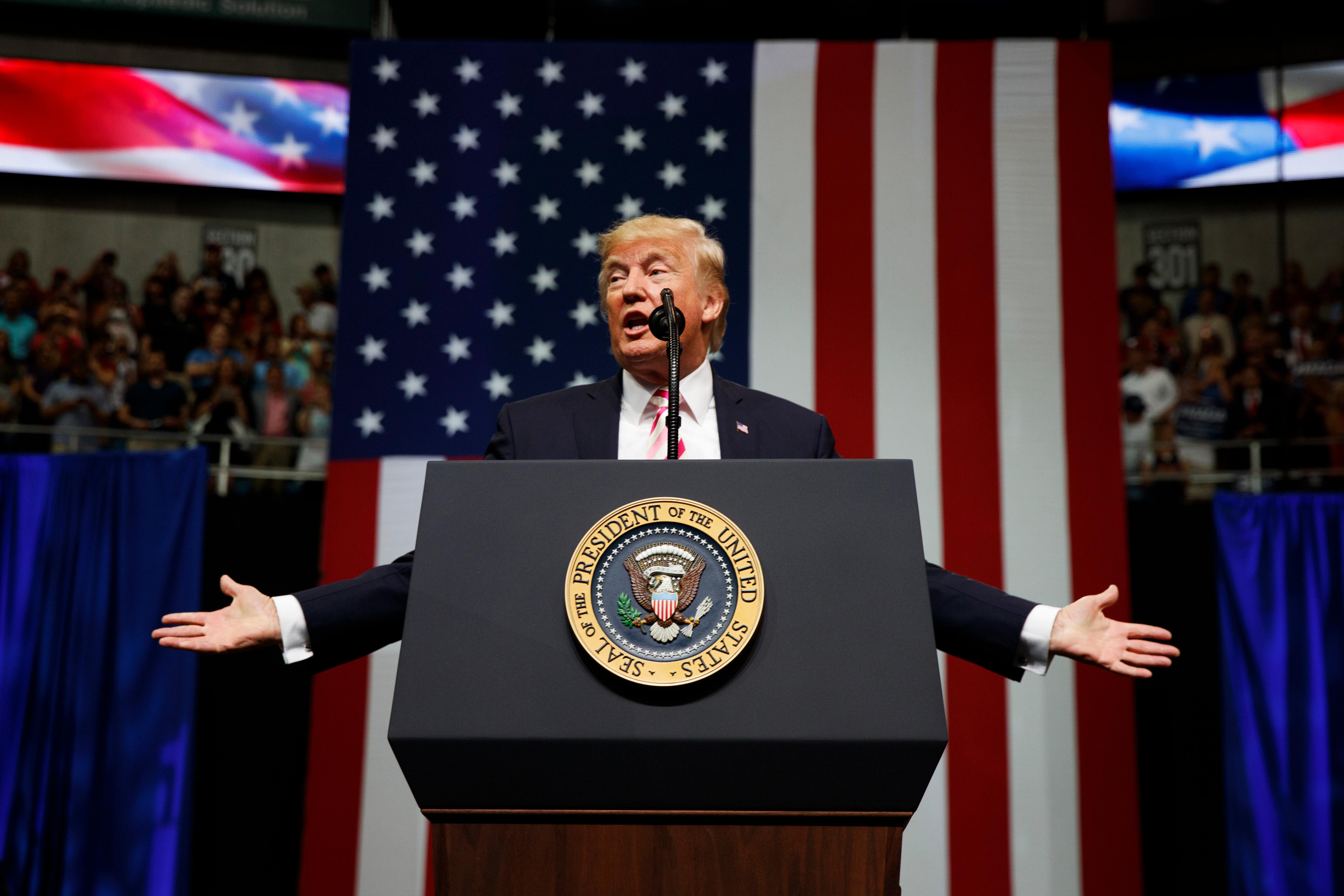 FILE - In this Friday, Sept. 22, 2017, file photo, President Donald Trump speaks at a campaign rally for Sen. Luther Strange, R-Ala., in Huntsville, Ala. Trump is expected to announce new restrictions on travel to the U.S. as his ban on visitors from six Muslim-majority countries sunsets Sunday, Sept. 24, 90 days after it went into effect. (AP Photo/Evan Vucci, File)