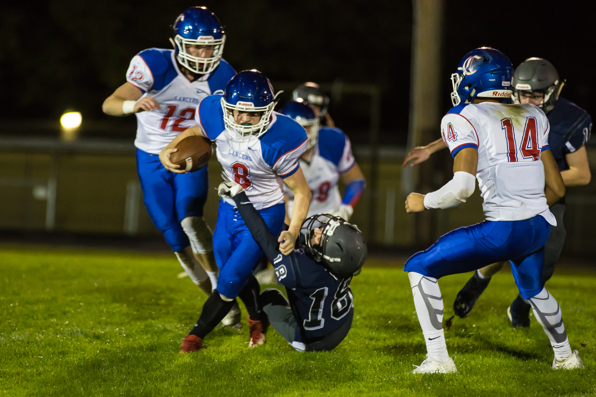 Churchill running back Dalton McDaniel (#8) runs the ball up the field. The Churchill Lancers defeated the Springfield Millers 56-7 in a cold game Friday night. Friday night's win extended Churchill's season to 7-0. Photo by Dillon Vibes
