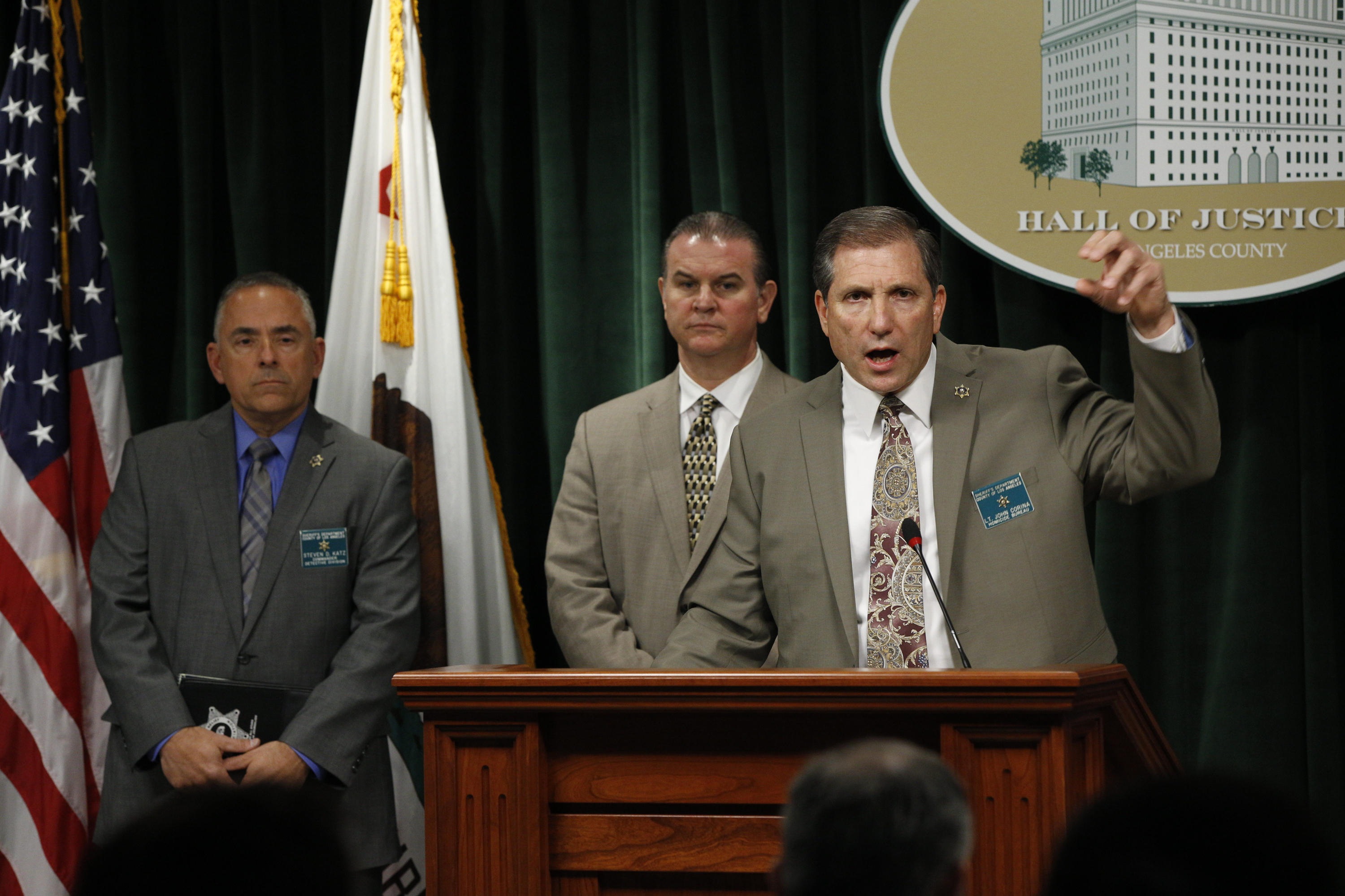 Los Angeles County Sheriff's Department officials, Commander Steve Katz, left, and Capt. Christopher Bergner, center, look on as Lt. John Corina, right, discusses the most recent details of the Natalie Wood death investigation at a news conference in Los Angeles, Monday, Feb. 5, 2018. Corina is hoping renewed interest in the 1981 death of Wood in the ocean off Southern California will produce more witnesses to shed light on what happened. (AP Photo/Damian Dovarganes)