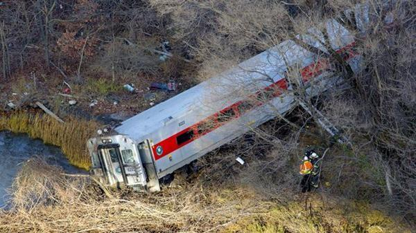 First responders view the derailment of a Metro North passenger train in the Bronx borough of New York.