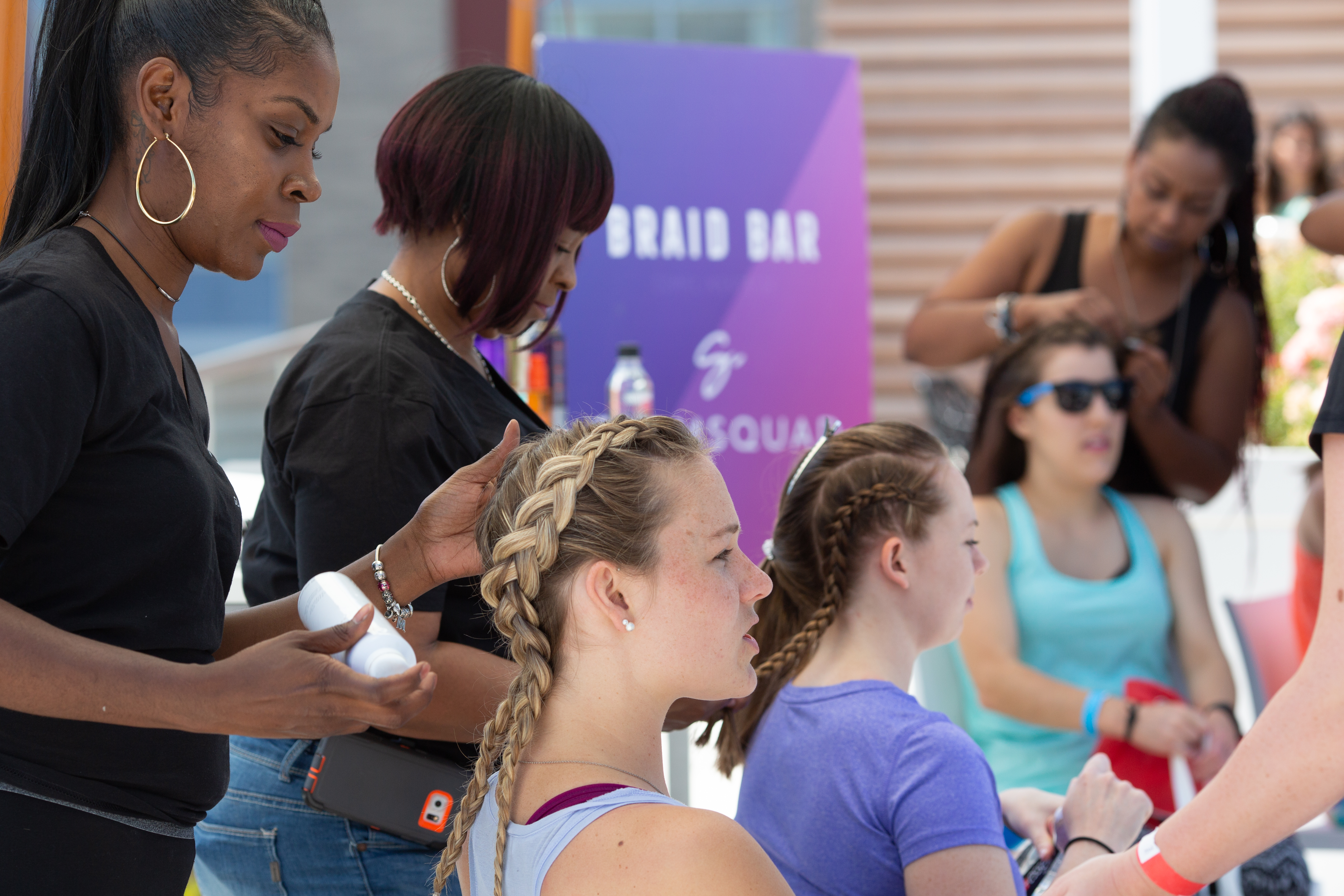 The day starts with a check-in party at 880 P rooftop, where attendees can get their hair braided, enjoy healthy treats and pick up their swag bag. (Image: Courtesy of Sweat Concierge)