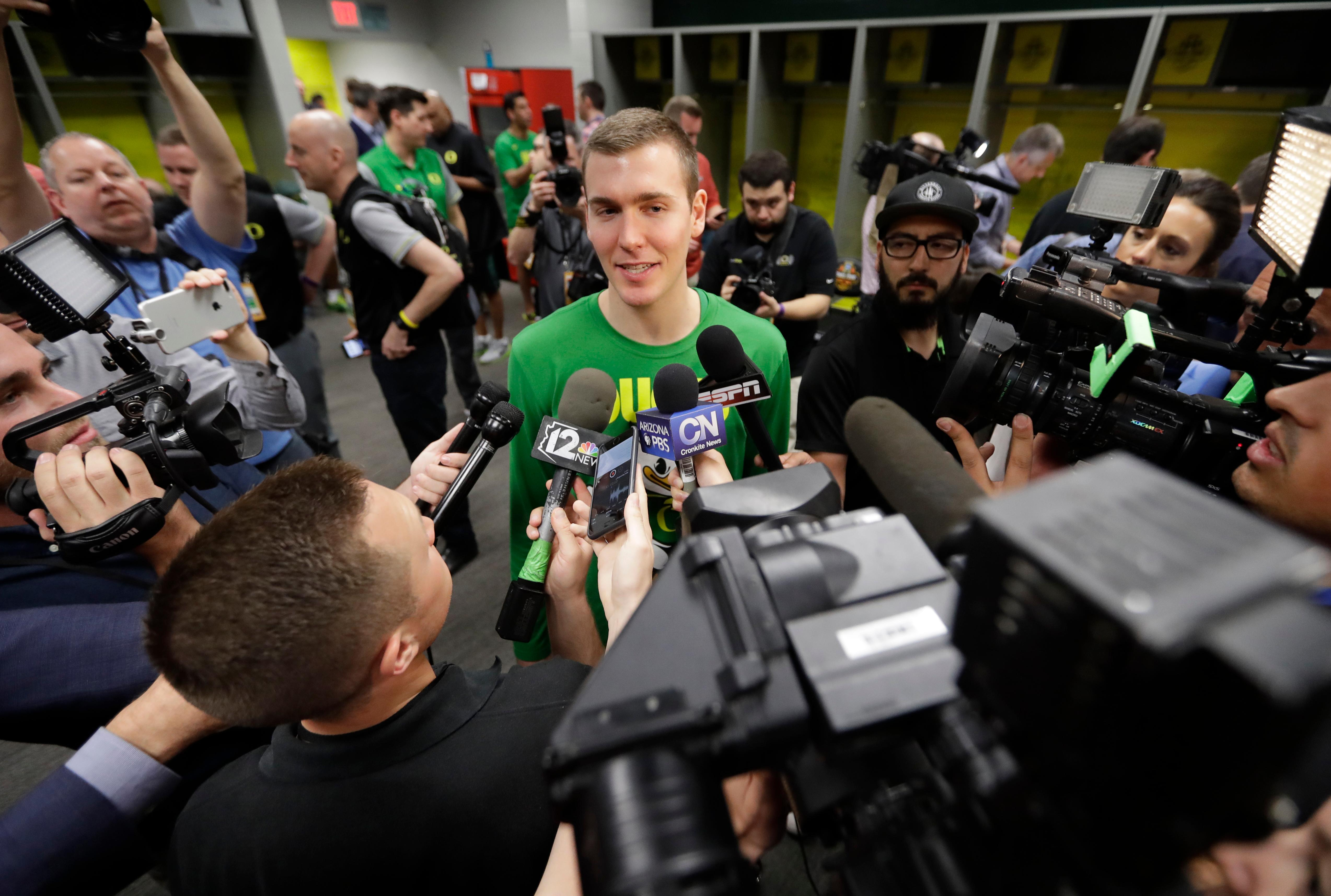 Oregon's Casey Benson answers questions after a practice session for their NCAA Final Four tournament college basketball semifinal game Thursday, March 30, 2017, in Glendale, Ariz. (AP Photo/David J. Phillip)