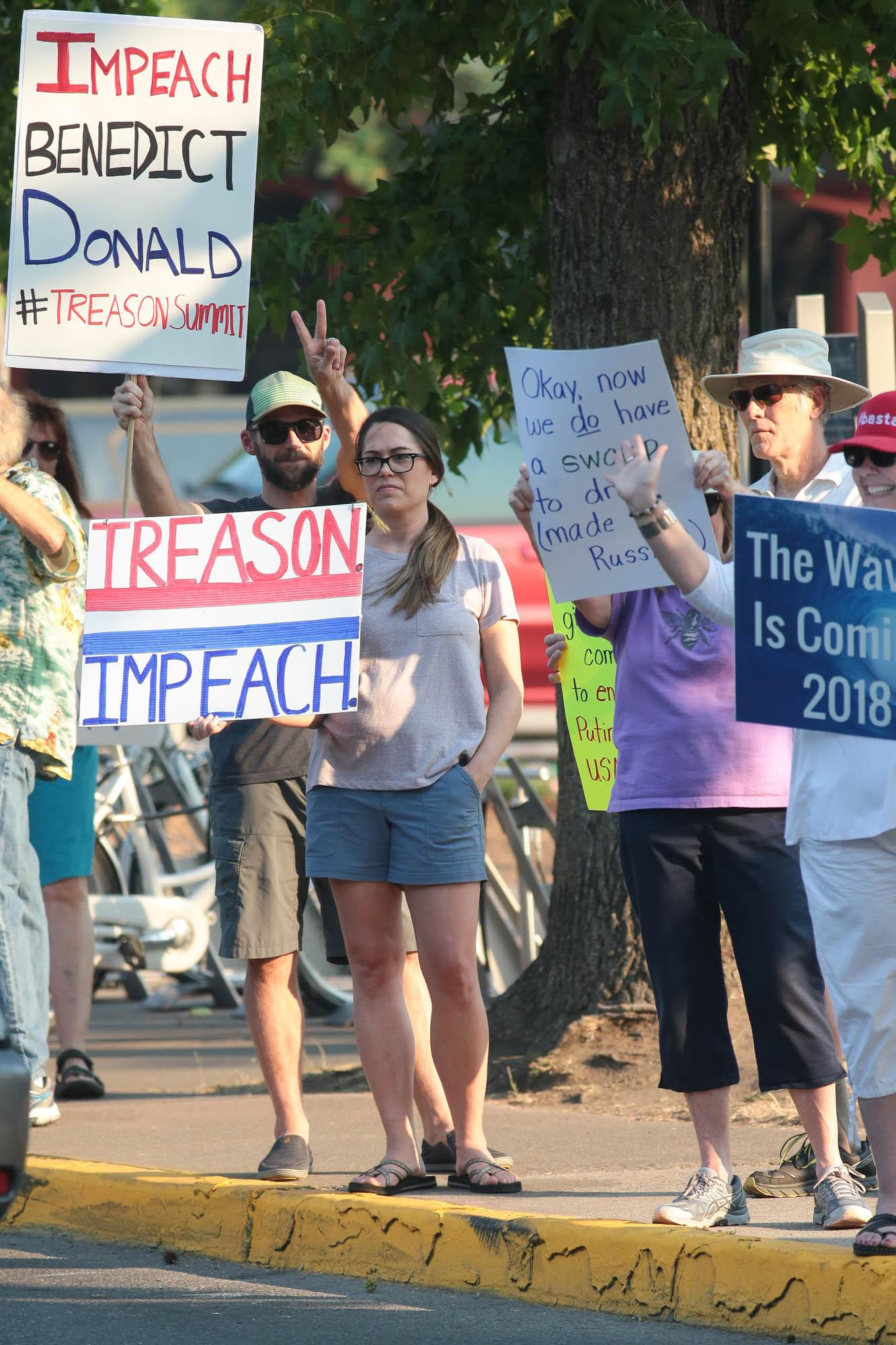 Photo by Larry Stauth Jr.Retired Army Officer Jennifer McKenzie joins other Area residents gathering in front of the Plaza on Main Street to protest President Donald Trump on Wednesday.