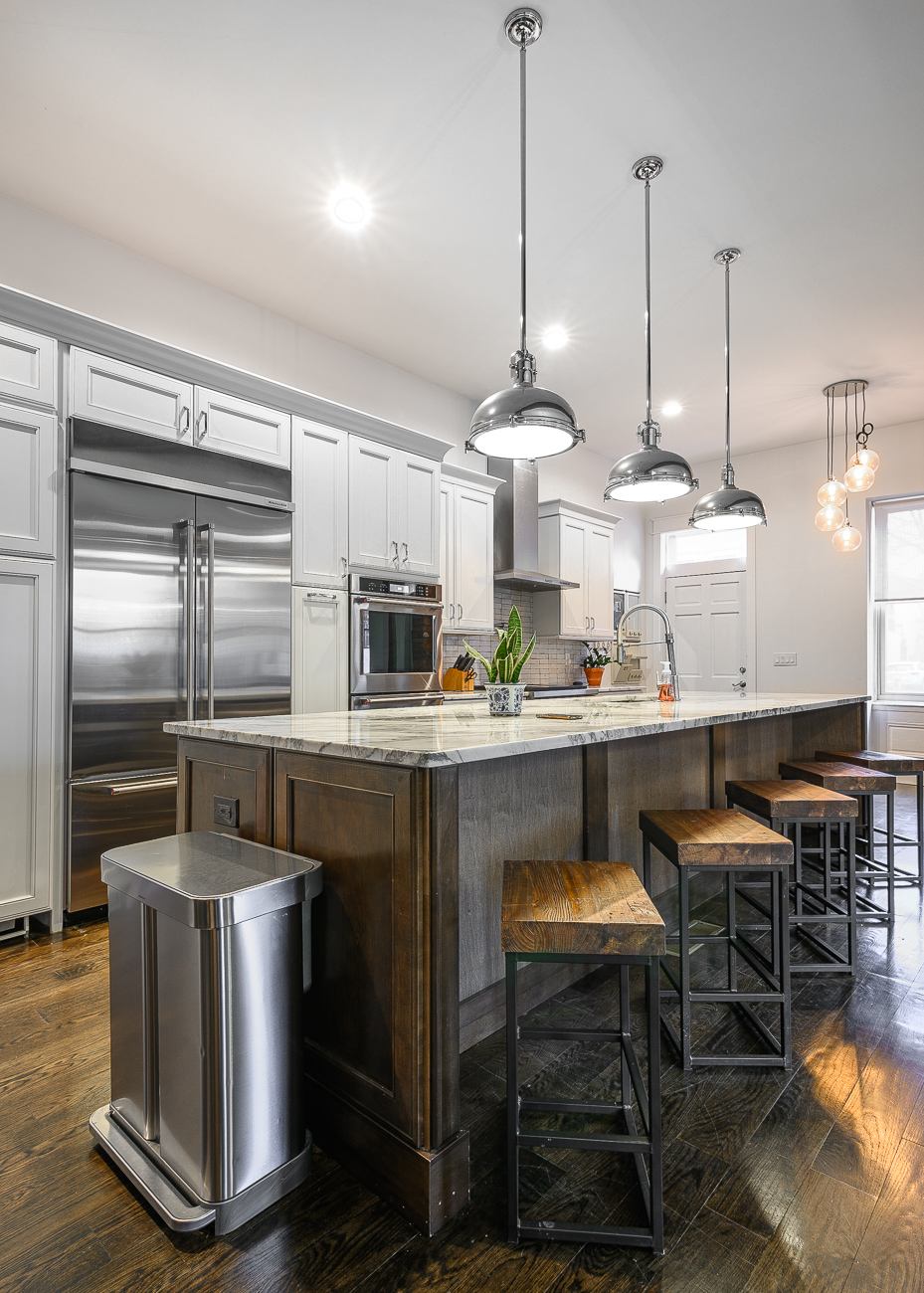 Eric loves to cook, so installing a gourmet kitchen was a priority when construction was underway to turn the formerly vacant building into a brand new residence. / Image: Phil Armstrong // Published: 12.6.19