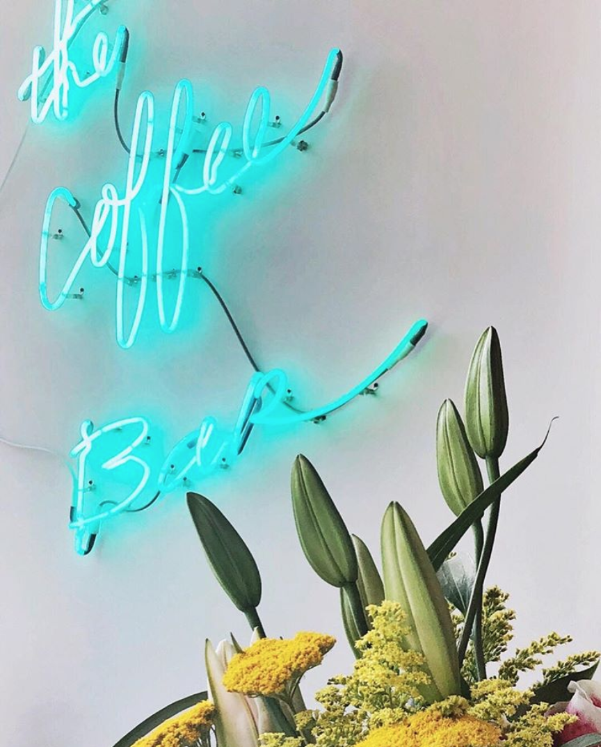 Neon signs are aesthetic and we love them. No shame here.(Image via @thecoffeebardc)
