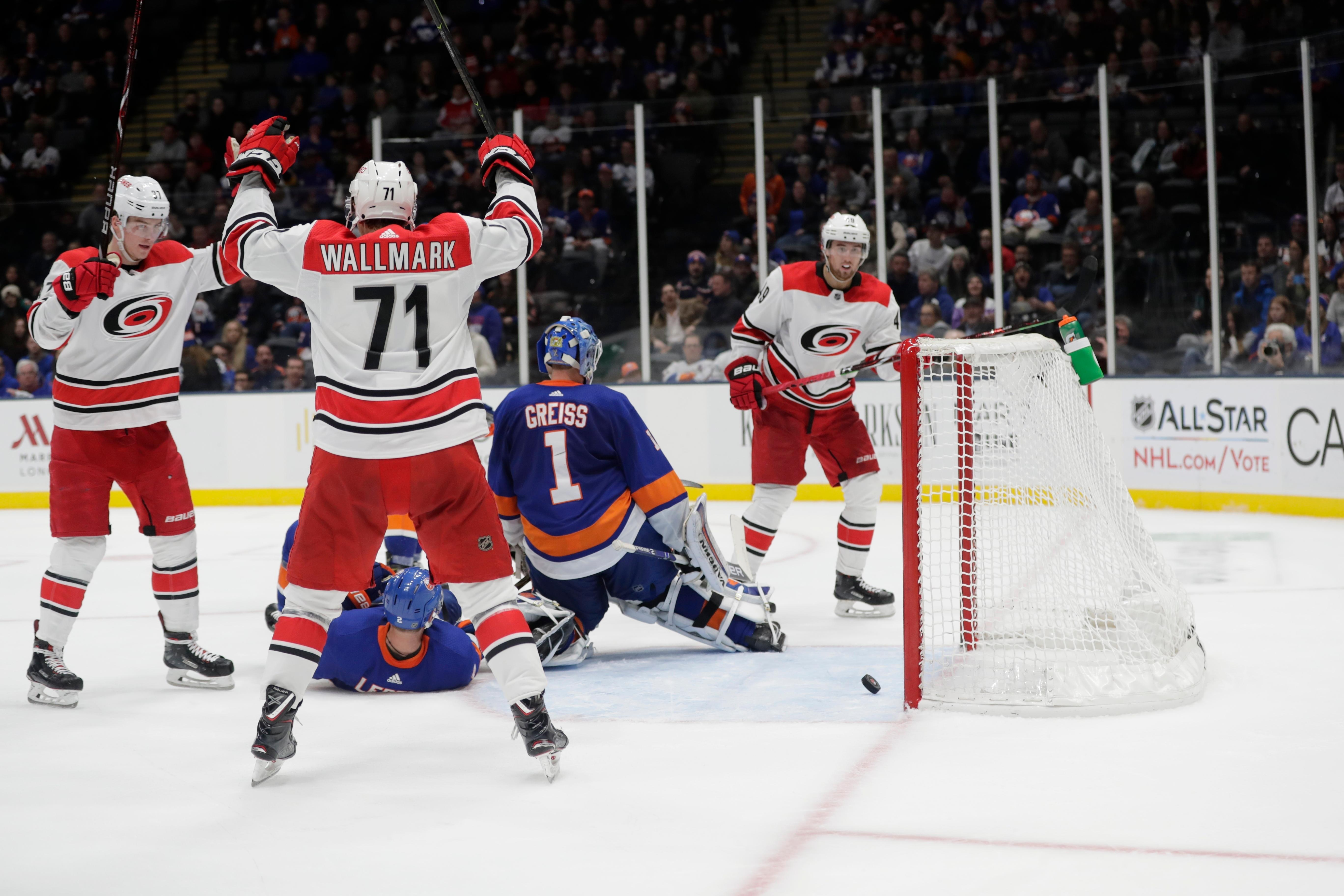 Carolina Hurricanes' Lucas Wallmark (71) celebrates with teammates after a shot by Jaccob Slavin got past New York Islanders goaltender Thomas Greiss (1) for a goal during the third period of an NHL hockey game Tuesday, Jan. 8, 2019, in New York. The Hurricanes won 4-3. (AP Photo/Frank Franklin II)