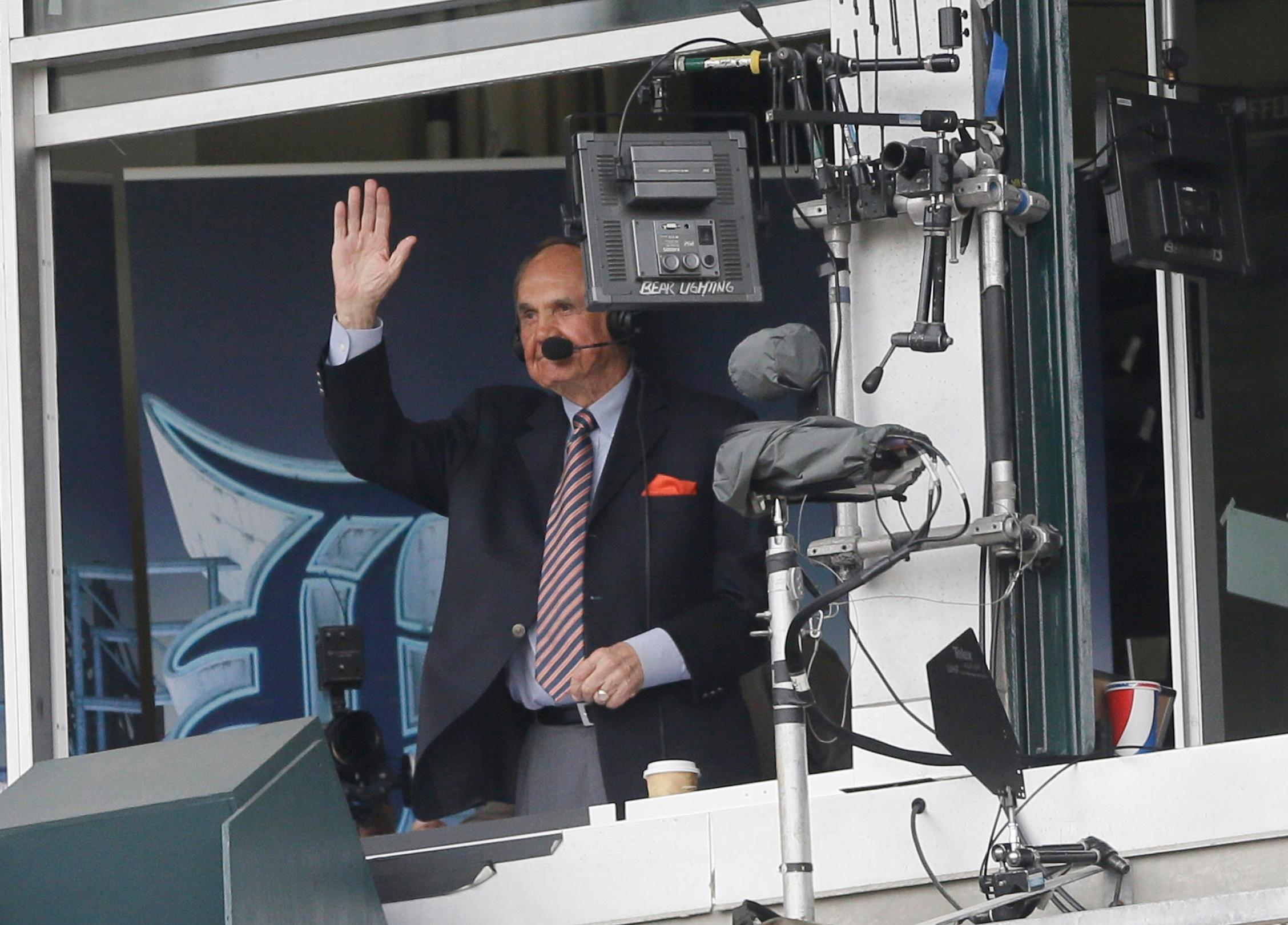 FILE - In this May 21, 2016, file photo, sportscaster Dick Enberg acknowledges the crowd during the first inning of a baseball game between the Detroit Tigers and the Tampa Bay Rays in Detroit. Enberg, the sportscaster who got his big break with UCLA basketball and went on to call Super Bowls, Olympics, Final Fours and Angels and Padres baseball games, died Thursday, Dec. 21, 2017. He was 82. Engberg's daughter, Nicole, confirmed the death to The Associated Press. She said the family became concerned when he didn't arrive on his flight to Boston on Thursday, and that he was found dead at his home in La Jolla, a San Diego neighborhood. (AP Photo/Carlos Osorio, File)
