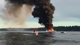 2 jump into Lake Washington to escape burning boat