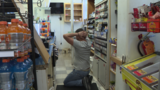 Store clerk demonstrates how he was held at gunpoint