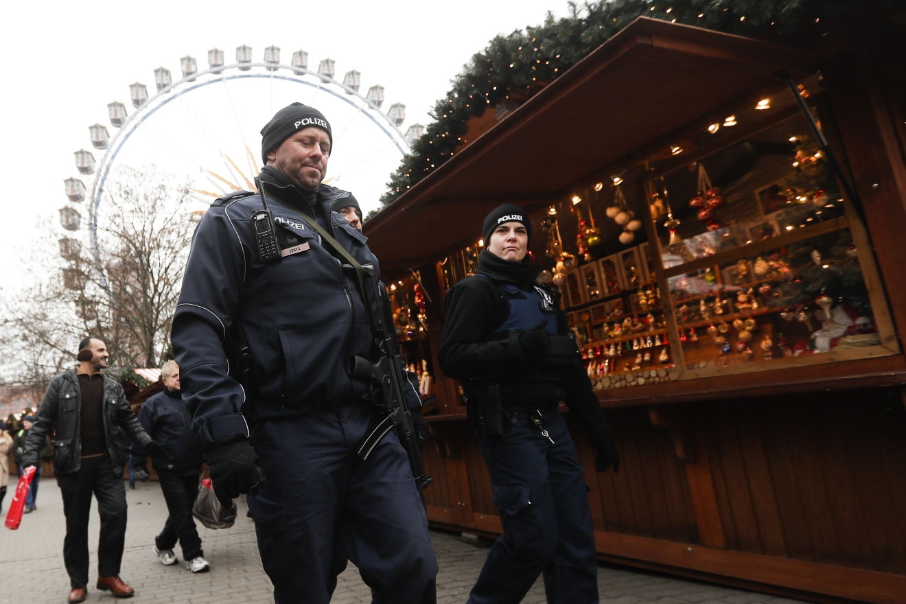 Police officers patrol over a Christmas market near the city hall in Berlin, Wednesday, Dec. 21, 2016, two days after a truck ran into the crowded Christmas market at the Breitscheidplatz in the city and killed several people. (AP Photo/Markus Schreiber)