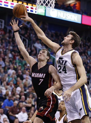 Miami Heat guard Goran Dragic, left, has his shot blocked by Utah Jazz center Jeff Withey, right, during an NBA basketball game Saturday, Jan. 9, 2016, in Salt Lake City. (AP Photo/George Frey)