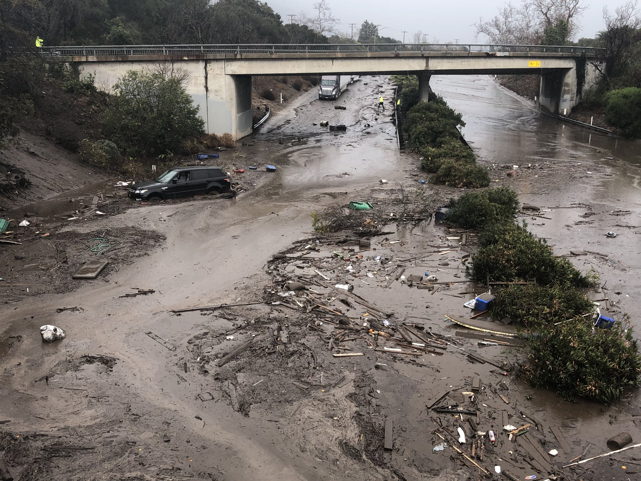 The US 101 Freeway at the Olive Mill Road overpass flooded with runoff water from Montecito Creek.{ }(Photo: Mike Eliason / Santa Barbara County Fire)