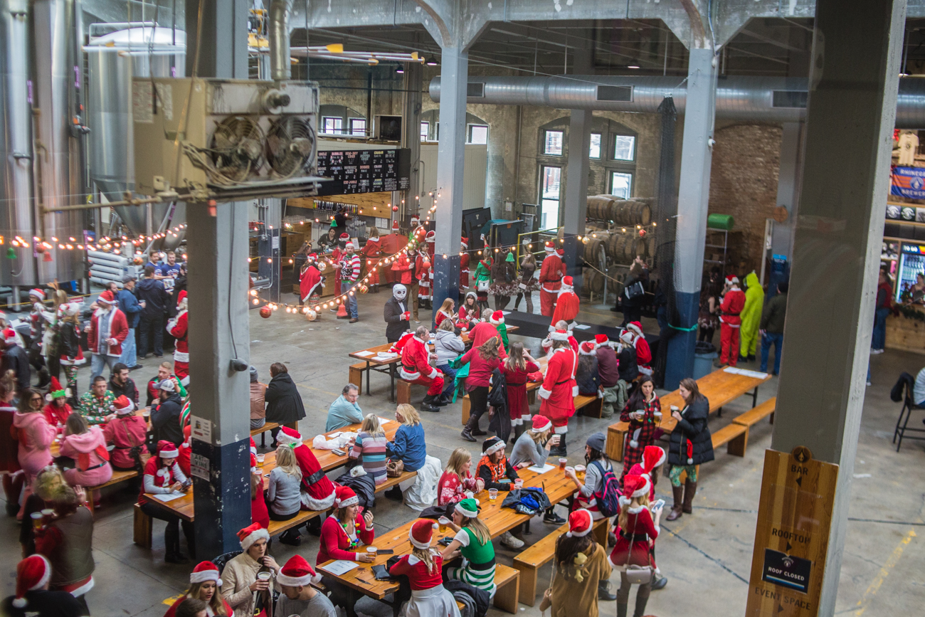 <p>The 10th Annual Cincinnati Santacon was held on Saturday, December 9, 2017. Participants of the pub crawl wore Christmas outfits and walked through Downtown Cincinnati spreading merriment and holiday cheer. / Image: Catherine Viox // Published: 12.10.2017<br></p>