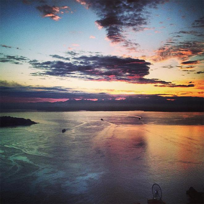 Colorful sunset over Elliott Bay as observed from the Columbia Tower (Photo Courtesy: Patrick Bell)