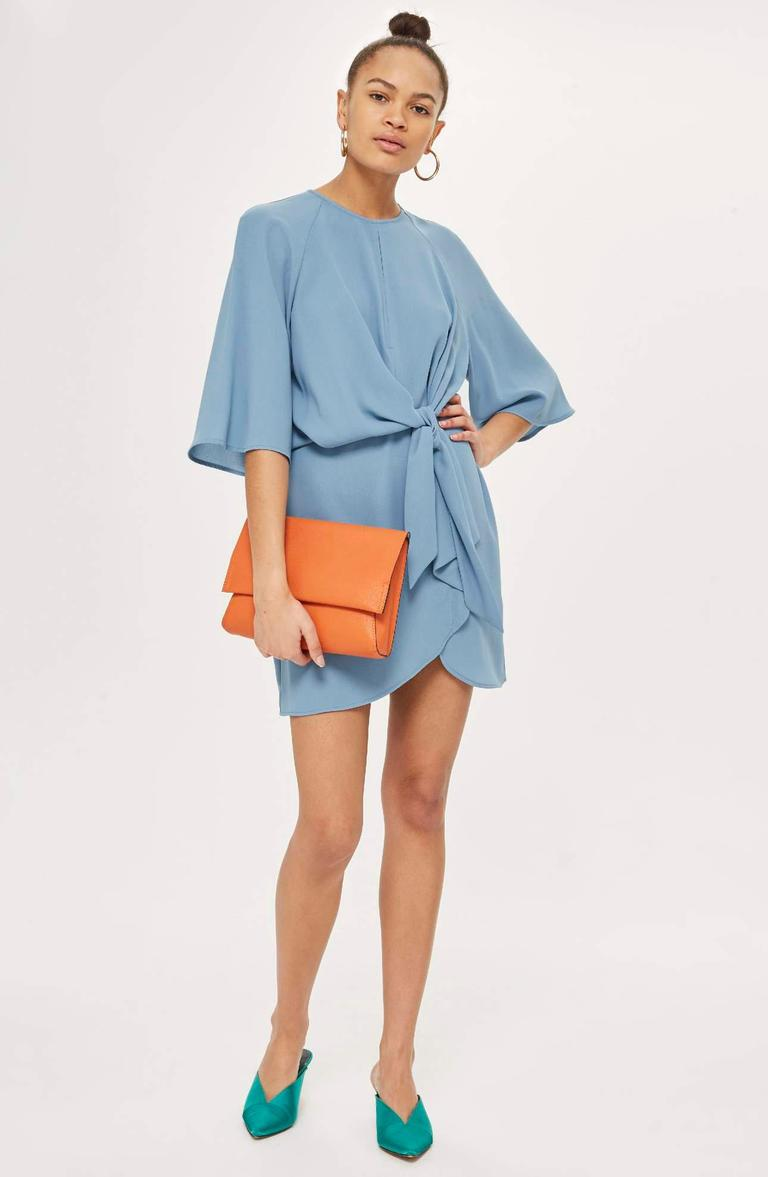 Flowy drape is the design aesthetic of this raglan-sleeve dress with a tulip-style skirt and panels that gather to knot at the front waist.<p>$80.00 at Nordstrom. (Image: Nordstrom){&amp;nbsp;}</p>