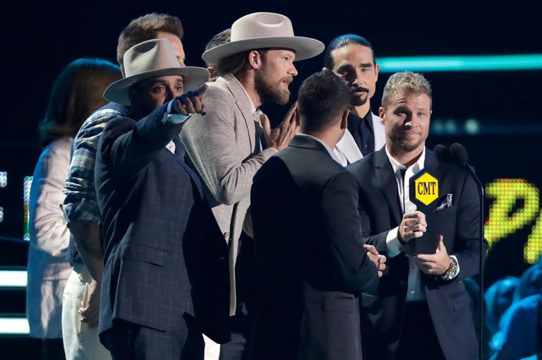 Musical groups Backstreet Boys and Florida Georgia Line accept the CMT performance of the year award{ } (AP Photo/Mark Humphrey)