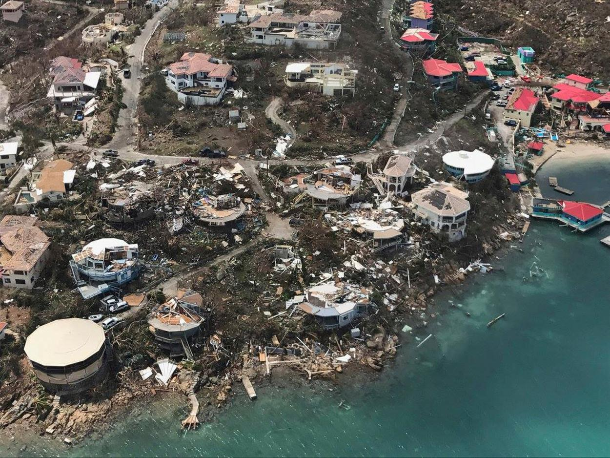This photo provided on Friday, Sept. 8, 2017, shows storm damage in the aftermath of Hurricane Irma in Virgin Gorda's Leverick Bay in the British Virgin Islands. Irma scraped Cuba's northern coast Friday on a course toward Florida, leaving in its wake a ravaged string of Caribbean resort islands strewn with splintered lumber, corrugated metal and broken concrete. (Caribbean Buzz Helicopters via AP)