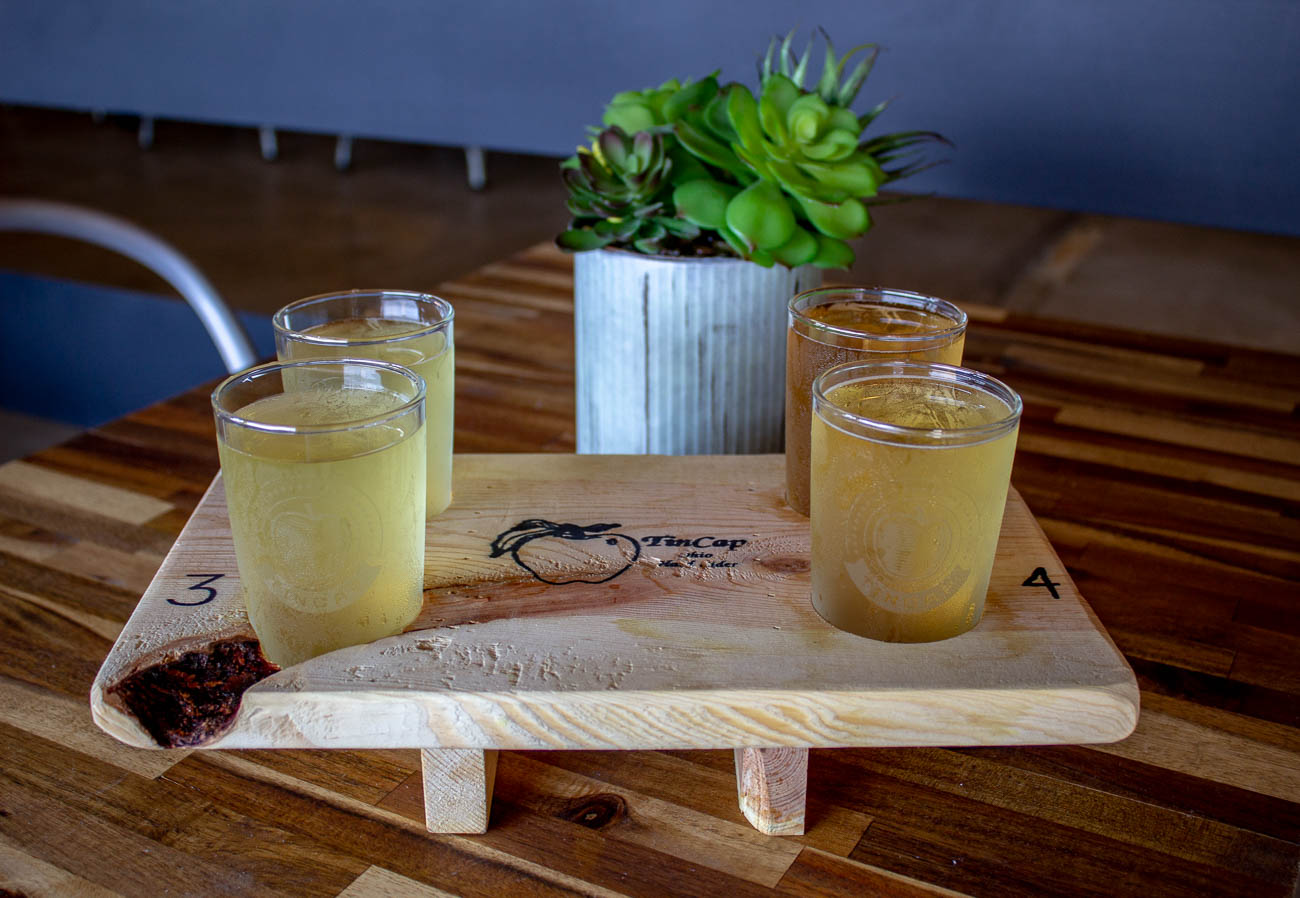 A cider flight featuring Peachy, Original TinCap, Jack's Mad Mango, and Blackberry / Image: Katie Robinson, Cincinnati Refined // Published: 7.22.19