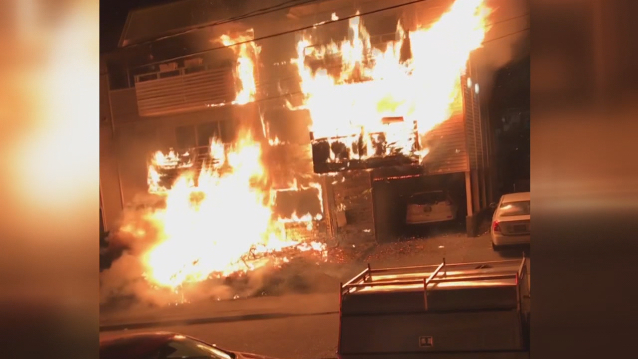 Screen capture off a viewer submitted video of a fire burning a West Seattle apartment building. (Video via: Fred Seefeld)