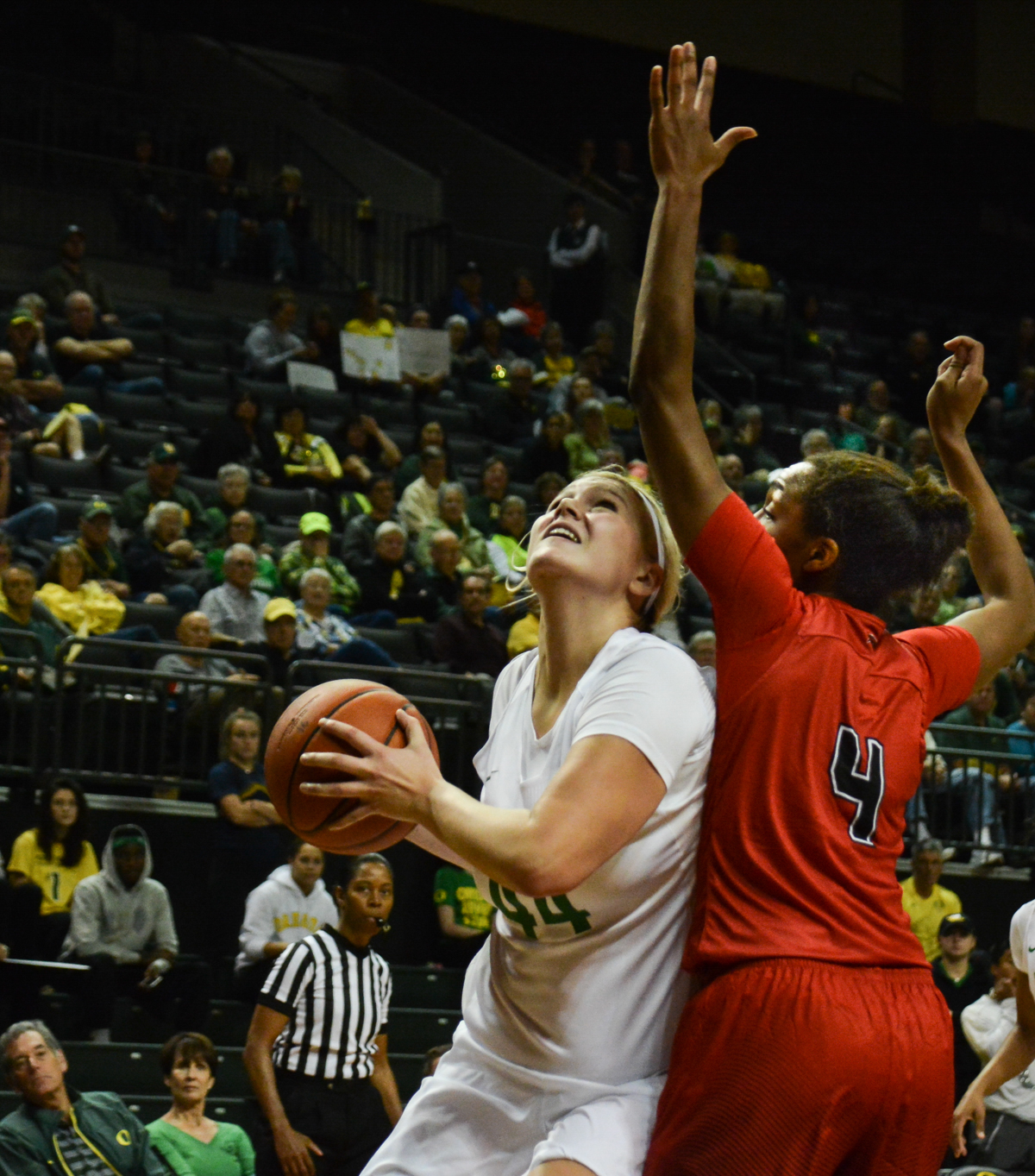 Ducks Mallory McGwire (#44) drives to the hoop against Cardinals point guiard Briana Laidler (#4). The Oregon Ducks women's basketball team won their season opener against the Lamar Cardinals 84-67. Photo by Jacob Smith, Oregon News Lab