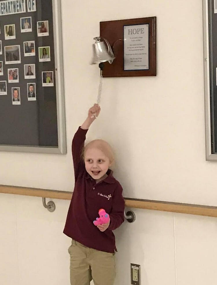 Kaylee Marshfield ringing the bell that she is cancer free. (Photo courtesy of Todd Marshfield)