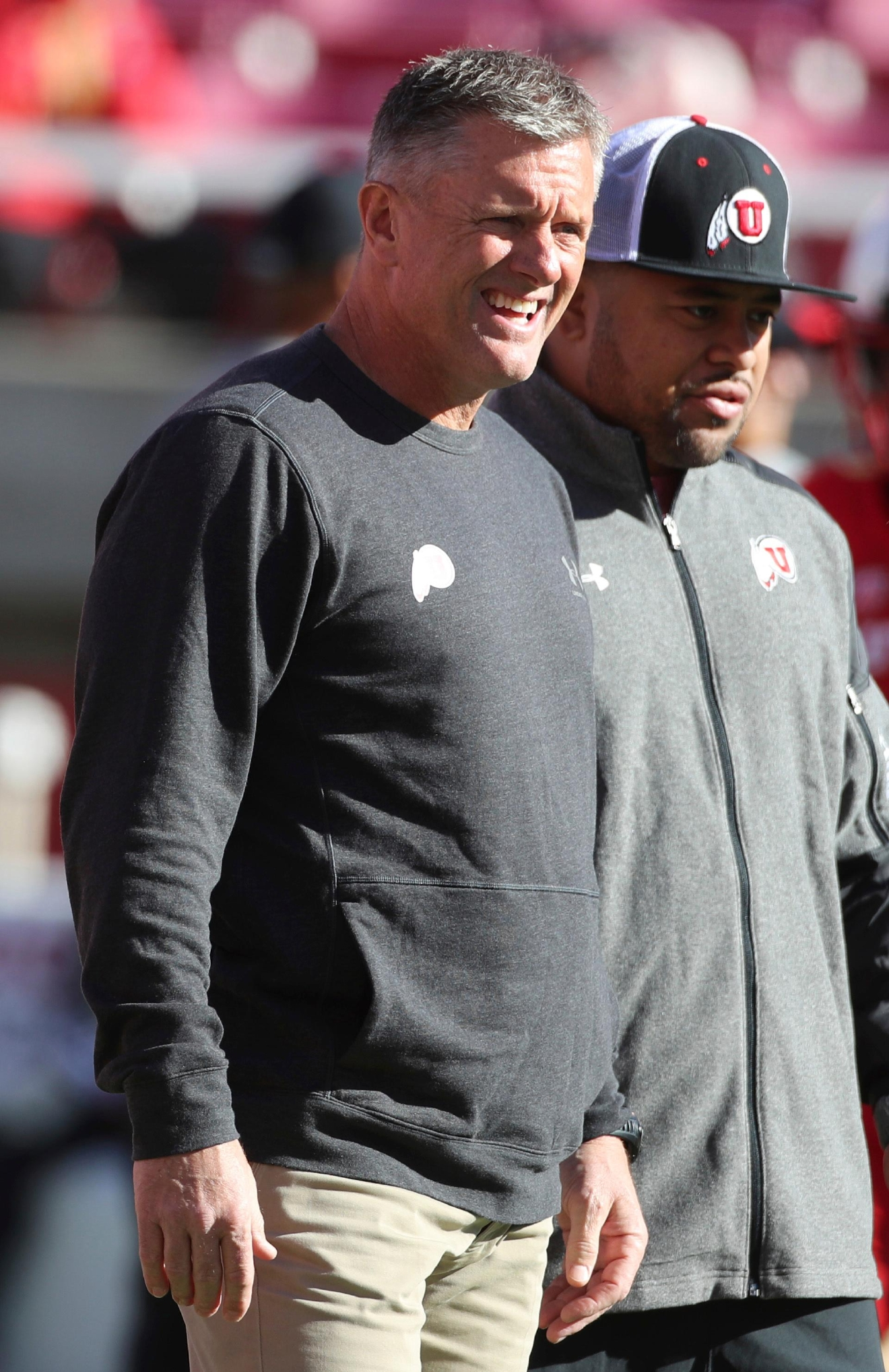 Utah head coach Kyle Whittingham watches his players warm up before an NCAA college football game against Oregon, Saturday, Nov. 19, 2016, in Salt Lake City. (AP Photo/George Frey)