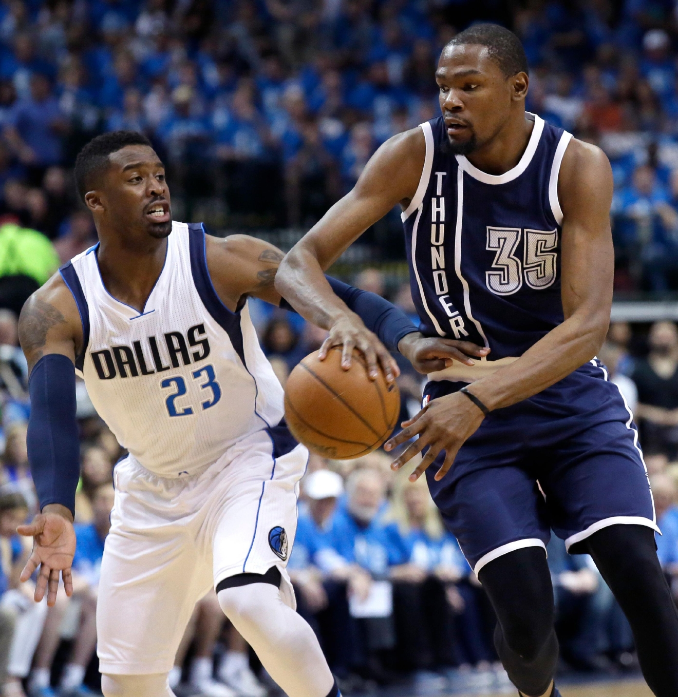 Oklahoma City Thunder forward Kevin Durant (35) drives against Dallas Mavericks guard Wesley Matthews (23) during the first half of Game 4 of a first-round NBA basketball playoff series Saturday, April 23, 2016, in Dallas. (AP Photo/LM Otero)